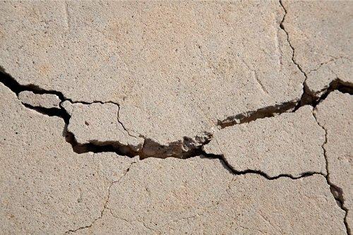 Cracked unleveled concrete floor