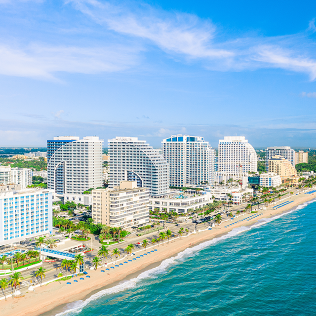 buildinga and white sand beach at fort lauderdale in florida